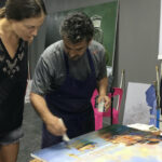 Art student at work and teacher